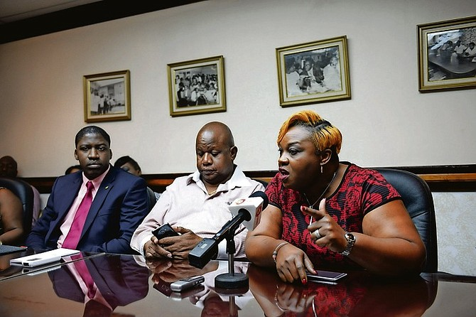 Nicole Martin, right, president of the BHCAWU, speaking at the National Congress of Trade Unions Bahamas (NCTUB) press conference yesterday to address the recent layoffs at the One&Only Ocean Club. Photo: Shawn Hanna/Tribune Staff