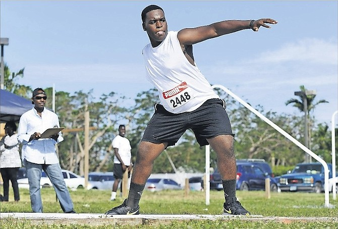 ATHLETES compete in the RC Athletics Throwers Meet at the University of the Bahamas field on Saturday.