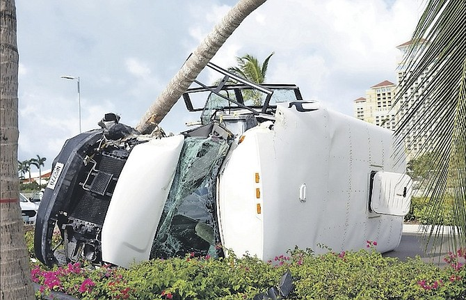 The wreckage of a bus carrying 24 students from St John's College and a teacher. The bus overturned, hitting a tree on West Bay Street near Baha Mar. Photo: Shawn Hanna/Tribune Staff