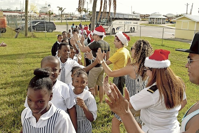 Some of the youngsters in Grand Bahama celebrating at the pre-Christmas party.