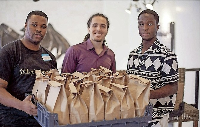 Members of the #HashtagLunchbag group prepared sandwiches with love for those in need.