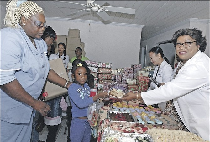 Some of the doctors and nurses helping to deliver gifts during Christmas.