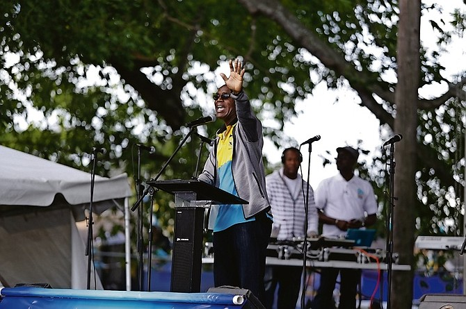 "Archdeacon James Palacious addresses supporters at the Majority Rule gospel concert on Tuesday, saying ""We live in a society where the rich gets richer and the poor get children"". Photo: Terrel W Carey/Tribune Staff"
