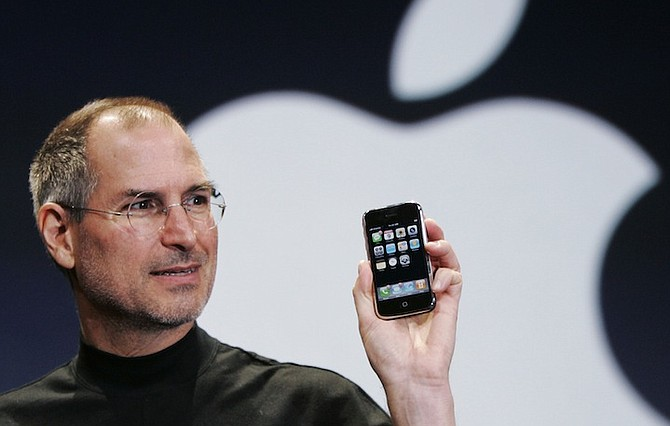 Apple CEO Steve Jobs holds up an iPhone at the MacWorld Conference in San Francisco in 2007. (AP)