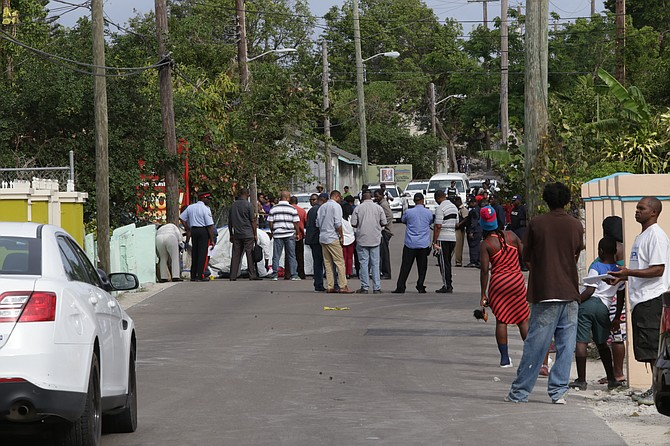 The scene at Kemp Road on Saturday morning, where a man was shot dead. Photo: Terrel W Carey/Tribune Staff