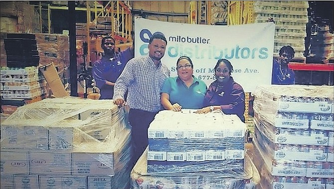 Milo Butler Distributors teamed up with Bahamas Red Cross to send supplies to islands impacted by Hurricane Matthew, with brand managers Jamarl Chea and Margo Gibson from the grocer.