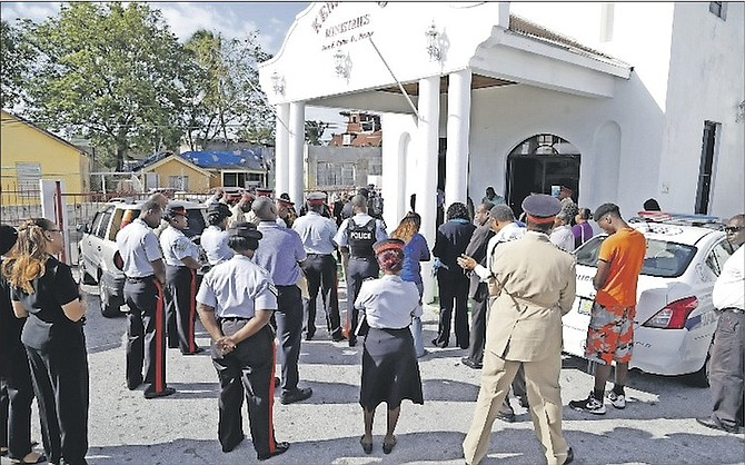The Royal Bahamas Police Force and church leaders held a walkabout in the Kemp Road area yesterday. Due to the recent homicides in the area, church leaders said prayers and anointing were needed for the community.  Photo: Terrel W. Carey/Tribune Staff