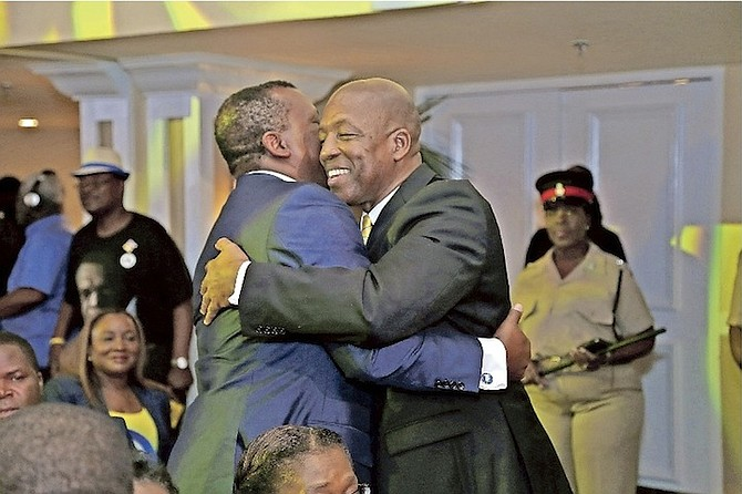 Alfred Sears is embraced by Picewell Forbes.  Photos: Terrel W. Carey/Tribune Staff