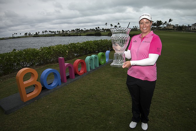 Brittany Lincicome with the Pure Silk-Bahamas LPGA Classic Trophy after her playoff victory over fellow American Lexi Thompson on Sunday