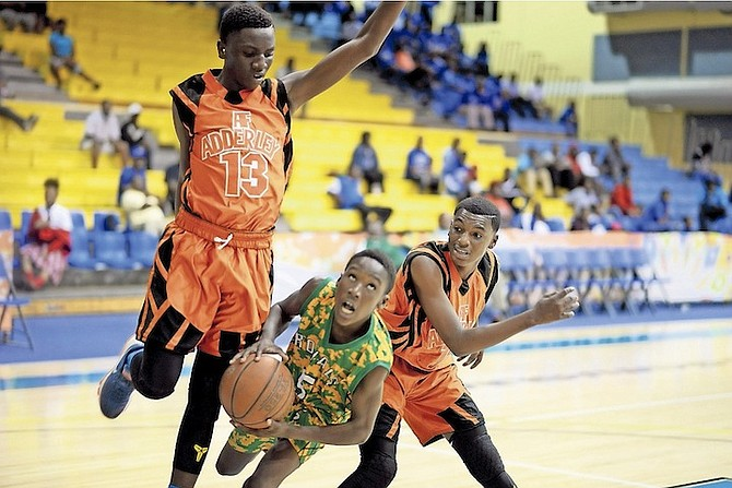 PLAY ACTION: The DW Davis Pitbulls defeated the AF Adderley Fighting Tigers 78-54 yesterday in the GSSSA basketball junior boys' championships series at the Kendal Isaacs Gym.                                                                                               Photo: Shawn Hanna/Tribune Staff