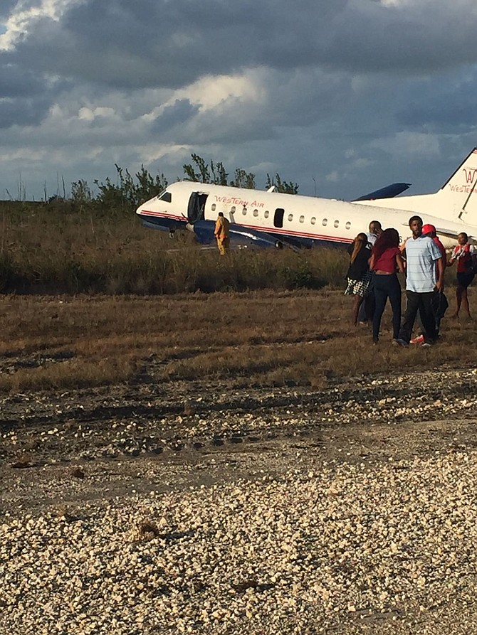 Passengers leave the Western Air plane which crash-landed at Grand Bahama International Airport on Tuesday afternoon.