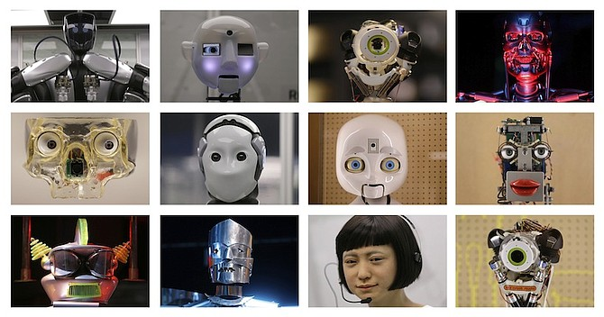 A selection of robot faces, from futuristic comic book to life-like newsreaders, on display during a press preview for the Robots exhibition at the Science Museum in London. (AP)