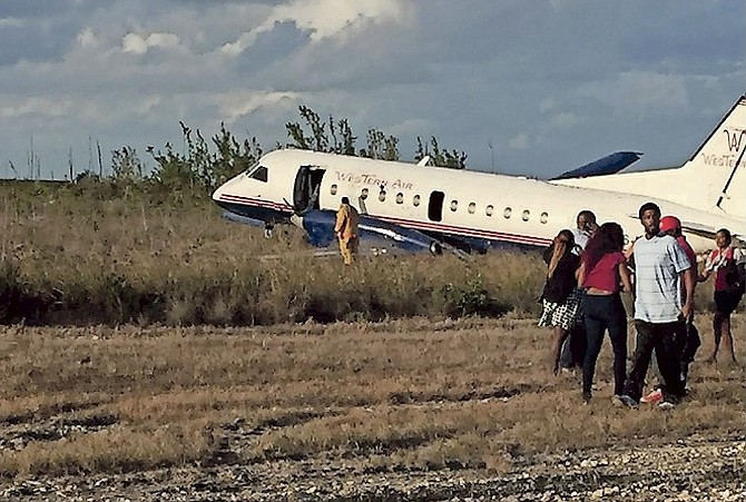 The scene on Tuesday after a Western Air plane crash landed at Grand Bahama International Airport.