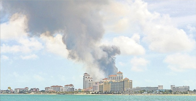 Baha Mar stands in the foreground as a tower of smoke rises behind it after a fire at the Harrold Road Landfill last year. Photo: Heather Carey