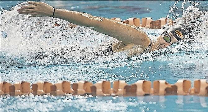 JOANNA EVANS in action at UT's Lee and Joe Jamail Texas Swimming Center on Saturday.