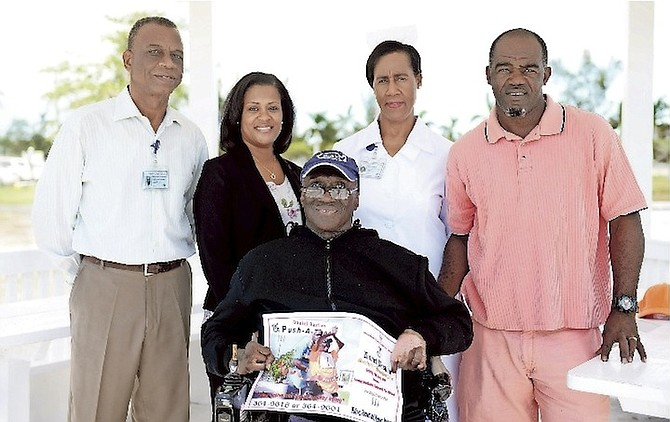 (L-R): Christopher Strachan, public relations officer at Sandilands Rehabiliation Centre (SRC); Dr Indira Grimes, SRC Geriatrics Ward consultant; Daniel Bastian, patron of the Push-a-thon; Sister Denise Smith, senior nursing officer in-charge of the Geriatrics Ward, and Shervin Brown, Mr Bastian's pusher and porter at the SRC Pharmacy.