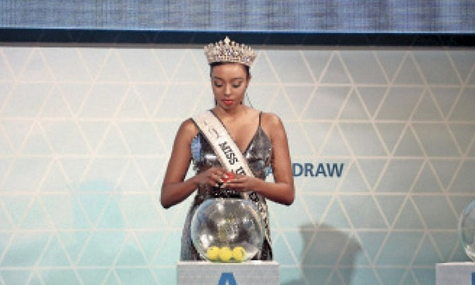 MISS BAHAMAS Universe 2016 Cherell Williamson does the honours of picking the positions in which the teams were placed in the four groups for the FIFA Beach Soccer World Cup.