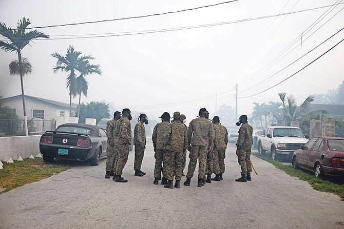 Defence Force officers in Jubilee Gardens on Sunday as smoke from the landfill forced residents to evacuate. Photo: Shawn Hanna/The Tribune