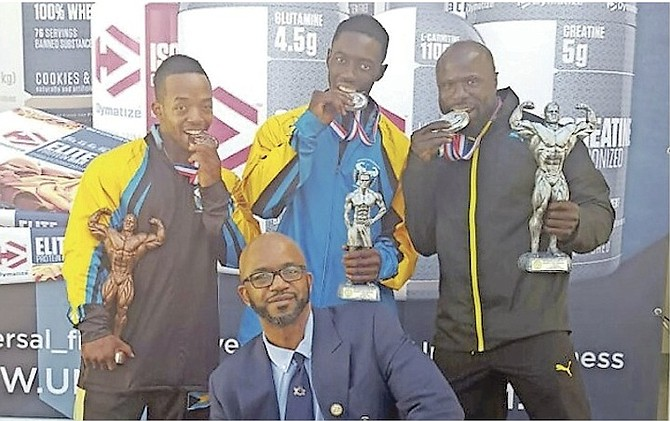 WELL DONE: Shown (l-r) are Paul 'Mighty Mouse' Wilson, Alberto Armbrister and Jimmy Norius with their awards. In front is coach-judge Wellington 'Cat' Sears.