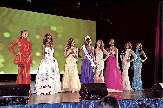 Contestants pose for a photo with the newest Miss Univeristy of the Bahamas Leadership Pageant winner.