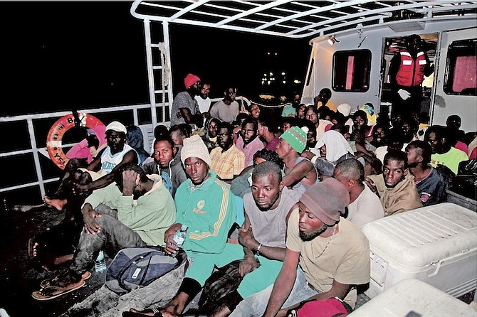 The suspected Haitian migrants after being apprehended in waters off the Exuma chain on Wednesday evening by the Royal Bahamas Defence Force.  Photo: Leading Mechanic Al Rahming/RBDF