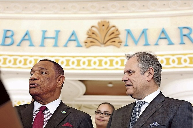 Prime Minister Perry Christie and Graeme Davis, CTFE president, pictured outside the Baha Mar casino on Tuesday. 
