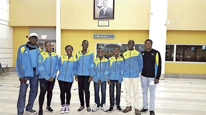 Coaches Bradley Bain (left) and Ricardo Demeritte (far right) with Junior Fed and Davis Cup team members Sydni Kerr, Sydney Clarke, Alana Mackey, Kofi Bowe, Denali Nottage and Donte Armbrister.