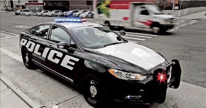 A prototype of the Ford Fusion police hybrid car sits along 11th Avenue in New York. (AP)
