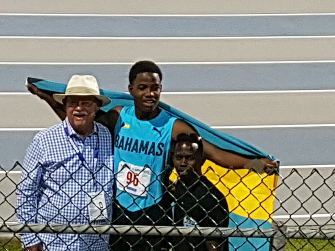 Carifta high jump gold medallist Shaun Miller with coaches Ronald Cartwright (left) and Keno Demeritte (right).