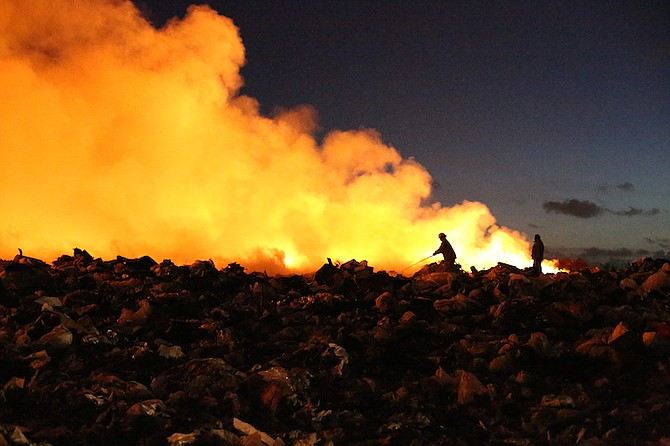 Firefighters tackle the blaze at the city landfill early on Wednesday. Photo: Terrel W Carey/Tribune Staff