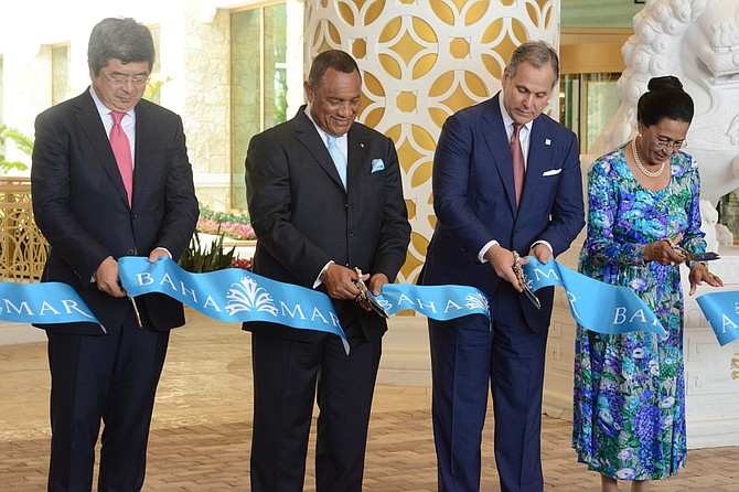 Governor General Dame Marguerite Pindling participates in the official ribbon cutting ceremony to declare the opening of Baha Mar phase one on Friday with Prime Minister Perry Christie, China Construction America President Ning Yuan and Baha Mar President Graeme Davis. Photo: Peter Ramsay/BIS
