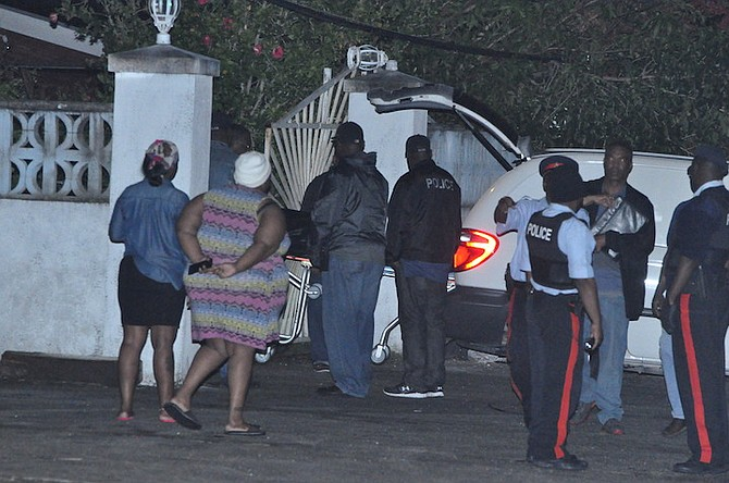 The scene on Amberjack Street, Freeport, on Sunday night after a young man had been found shot dead. Photo: Vandyke Hepburn/BIS
