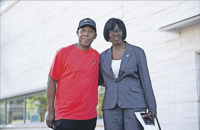 Grammy Award-winning artist Jeffrey Osborne is pictured with Mavis Darling-Hill, chairperson of the Kingdor National Parkinson Foundation, arriving at the Sir Lynden Pindling International Airport. Photo/Shawn Hanna