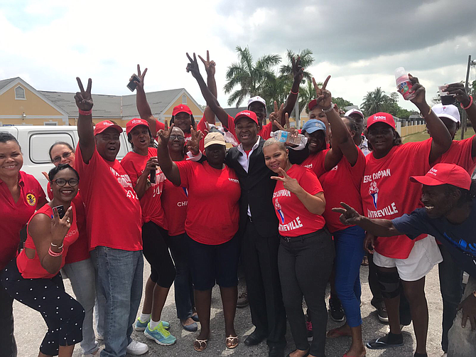 Jubilant Free National Movement supporters celebrate outside St Columbus Primary School on Friday morning as Reece Chipman's defeat of Perry Christie in the Centreville constituency after an all-night recount is confirmed. Photo: Ava Turnquest/Tribune Staff