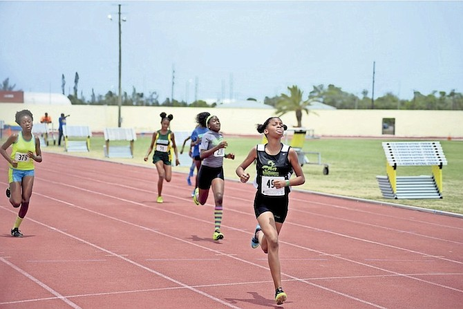 YOUNG athletes compete in the Ambassadors' Annual Fritz Grant Track and Field Invitational at the original Thomas A Robinson Track and Field Stadium on Saturday. Photo: Shawn Hanna/Tribune Staff