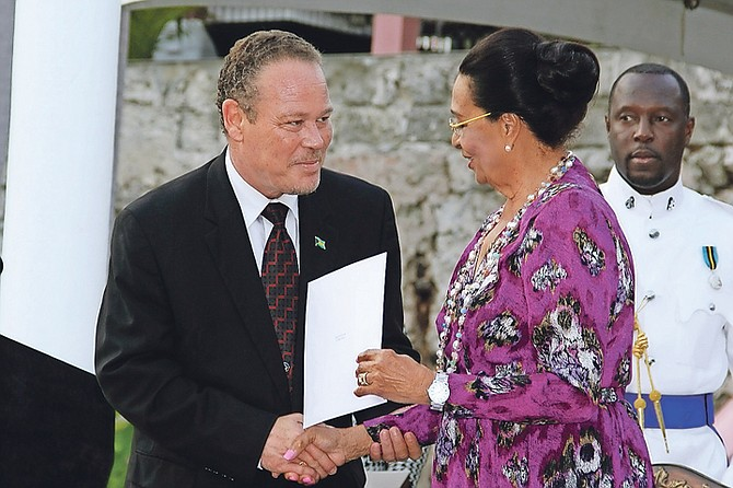 Carl Bethel is sworn in as Attorney General by Governor General by Governor General Dame Marguerite Pindling.