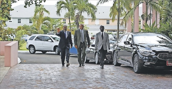 Dr Duane Sands, centre, arriving for the first Cabinet meeting under the new government at the Office of the Prime Minister on Tuesday. Photo: Terrel W. Carey/Tribune Staff