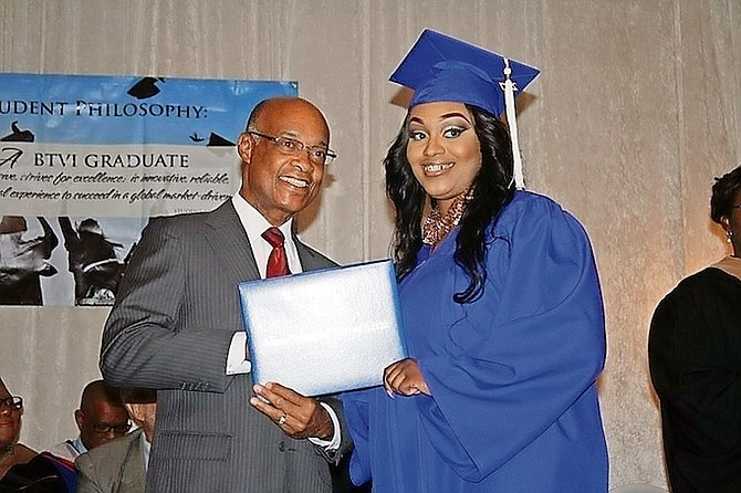 New Minister of Education Jeffrey Lloyd presents a graduand with her diploma cover during BTVI's 2017 commencement exercise at the Melia Nassau Beach Resort. Photos: Shantique Longley/BTVI