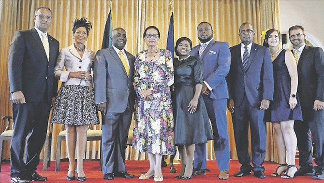 Philip Brave Davis, Opposition Leader along with his wife Anne-Marie and Governor General Dame Marguerite Pindling with the official Senators of the Opposition and their families after being sworn in yesterday at Government House. Photos: Shawn Hanna/Tribune Staff