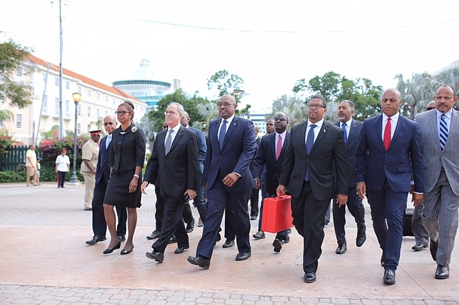 The Cabinet make their way to Parliament for the budget communication. Photo: Terrel W. Carey/Tribune Staff