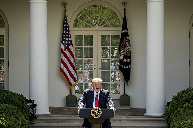 President Donald Trump speaks about the US role in the Paris climate change accord on Thursday, June 1, in the Rose Garden of the White House in Washington.