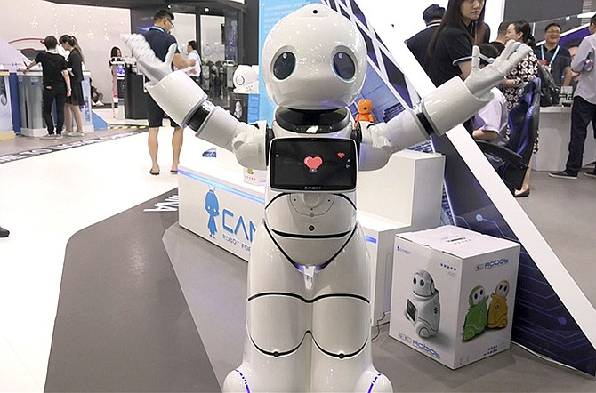 THE Canbot from Beijing's Canny Unisrobo Technology Co. Ltd. performs at the Shanghai CES electronic show in Shanghai, China. (AP)