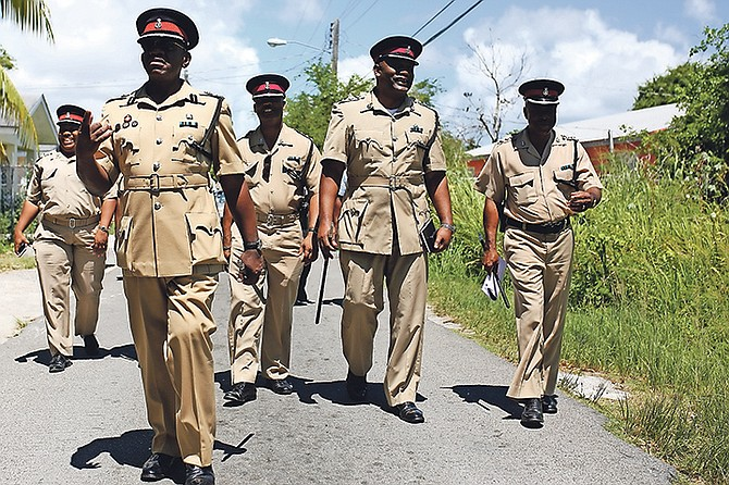 The Royal Bahamas Police Force conducted a walkabout in Foxhill as a result of the number of recent shootings in the area. Photos: Terrel W. Carey/Tribune Staff