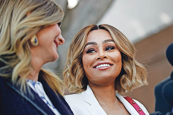 Blac Chyna, right, and her attorney Lisa Bloom smile at a news conference outside a courthouse on Monday, July 10, 2017, in Los Angeles. A court commissioner has granted Chyna a temporary restraining order against her former fiancee, reality television star Rob Kardashian. Photo: Jae C. Hong/AP