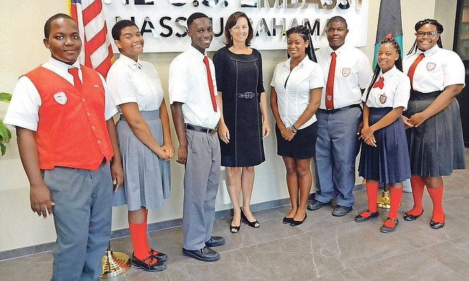 US Charge d'Affaires Lisa Johnson with youth ambassadors and chaperone Clive Ferguson, Kareem Minnis, Sky Cartwright, Tranique Brown, Wynter Curtis and Waydero Rolle and Latrell Bethel.