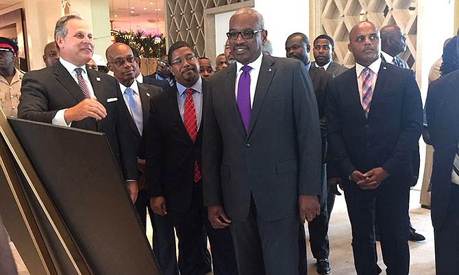 Prime Minister Dr Hubert Minnis (centre) with Education Minister Jeffrey Lloyd, Deputy Prime Minister and Minister of Finance K Peter Turnquest and National Security Minister Marvin Dames at the Baha Mar resort.