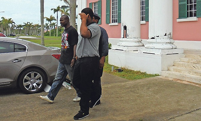 Karame Styles in grey and George Willie in black shirt at far side, at Freeport Magistrate's Court. Photo: Derek Carroll