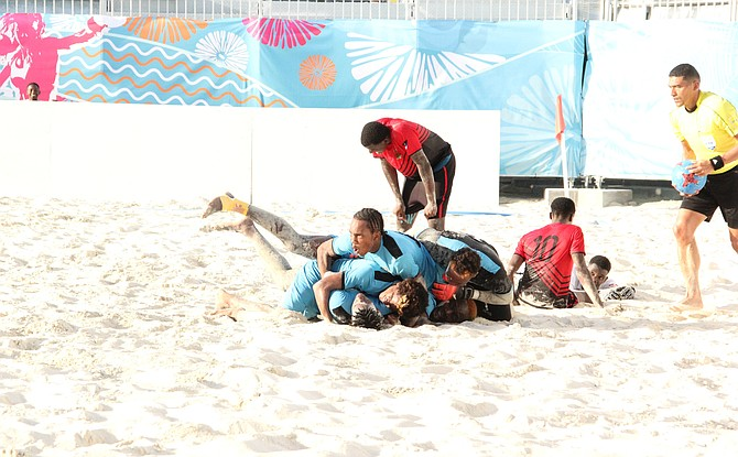 The Bahamas men's beach soccer team celebrate their bronze medal. Photo - Clarence Rolle CYG