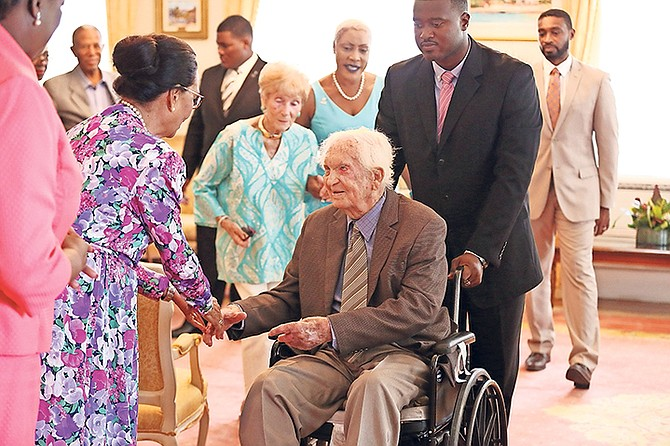 Governor General Dame Marguerite Pindling greets Sir Durward Knowles during a courtesy visit yesterday at the start of a 100-day countdown to his 100th birthday. Photo: Terrel W. Carey/Tribune Staff