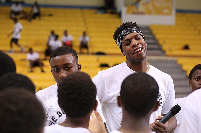 BUDDY Hield meets youngsters during his basketball workshop at the weekend. Photo: Terrel W. Carey/Tribune Staff